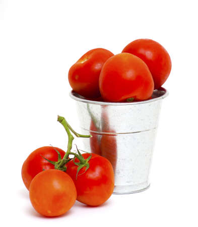 bucket with tomatoes isolated photo