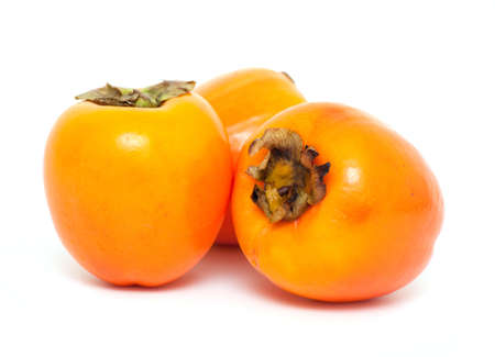 ripe persimmons on white background photo