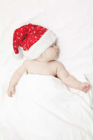 hat nude: sleeping baby in santas hat