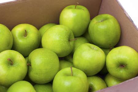 box full of green apples photo