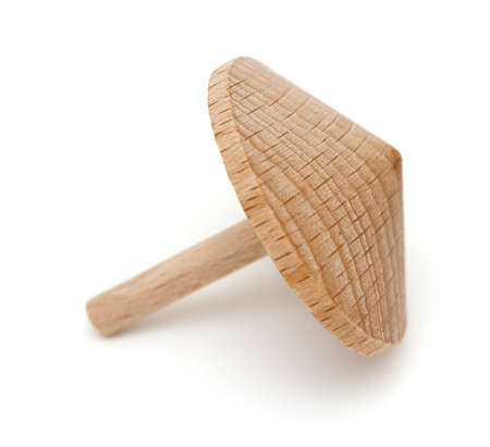 artisanal: wooden spinning top isolated Stock Photo