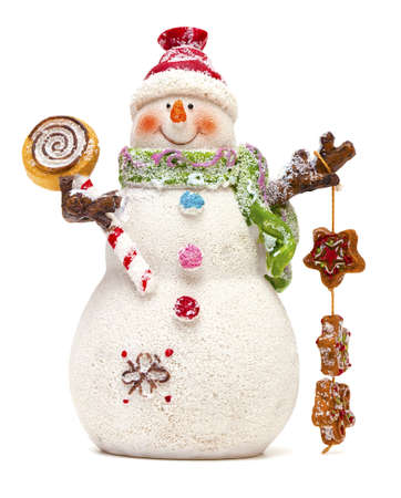 snowman with sweets isolated on white background photo