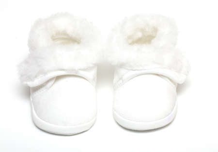pair of white baby boots isolated on white Stock Photo - 14463481