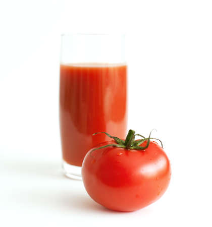 tomato and glass of tomato juice photo