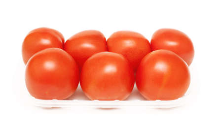 tomatoes in plastic plate on white background photo