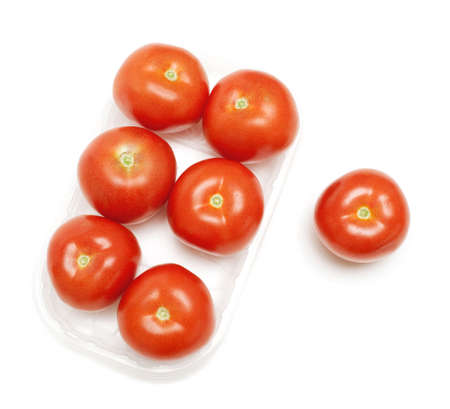 tomatoes in a plastic box on white background photo