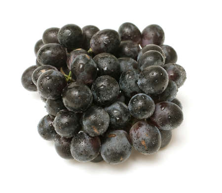 bunch of black grapes with droplets on white background photo