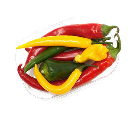 different kinds of hot pepper on white background, top view photo
