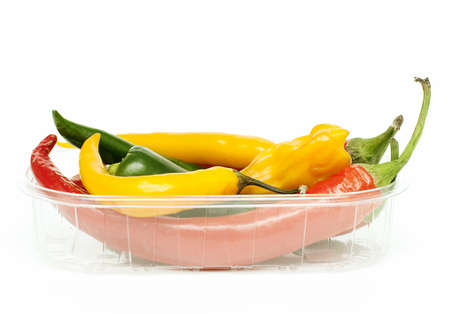 different kinds of hot pepper on white background photo