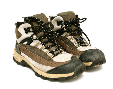 pair of hiking shoes on white backrgound photo