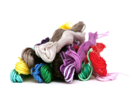 warm things: multicolored cotton threads on white background