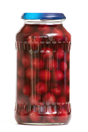jar with preserved cherries on white background
