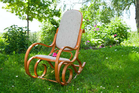 rocking chair: rocking chair with pink rose in spring garden