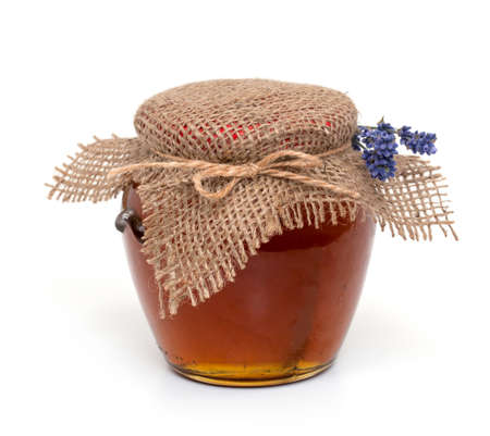 jar of lavender honey over white photo