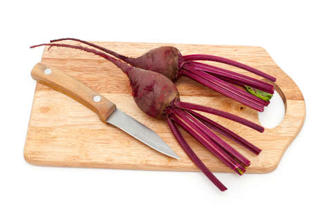 beet root on cutting board over white photo