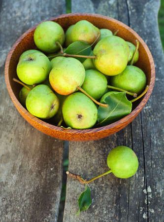 fresh pears in a bowl on wooden table Stock Photo - 14650534