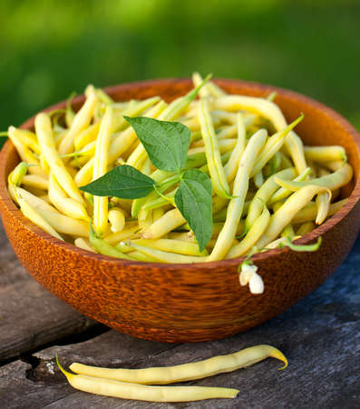 yellow kidney beans in a bowl on wooden table Stock Photo - 14708922