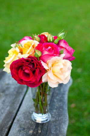 beautiful bouquet of different roses on wooden table Stock Photo - 14708927