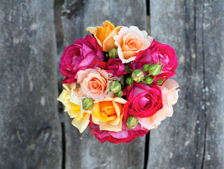 beautiful bouquet of different roses on wooden table Stock Photo - 14708884