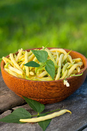 yellow kidney beans in a bowl on wooden table Stock Photo - 14766606