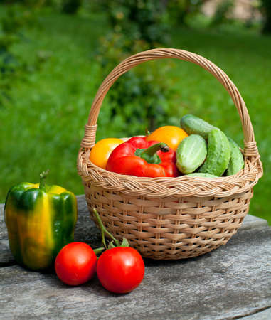 vegetables in a basket on wooden table photo