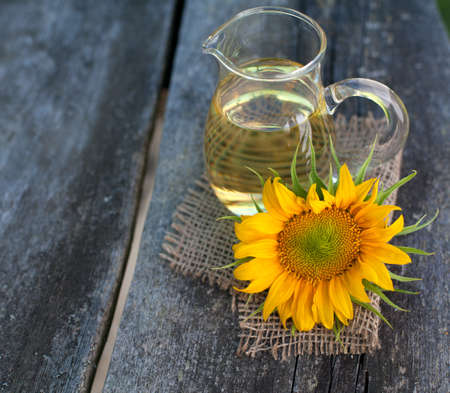sunflower oil on wooden table photo