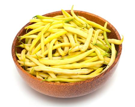 yellow beans in a bowl isolated on white background photo