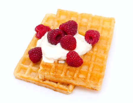waffles with whipped cream and raspberrries