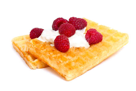 waffles with whipped cream and raspberrries photo