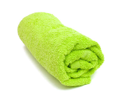 fresh rolled green towel isolated on white background photo