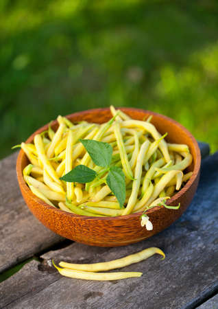 yellow kidney beans in a bowl on wooden table Stock Photo - 14951408