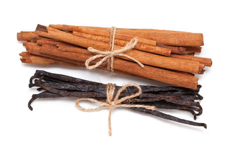 stick of cinnamon: tied cinnamon and vanilla beans isolated on white backgorund