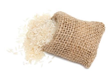 basmati rice in a miniature burlap bag isolated on white photo