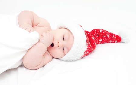 4 months belly: baby in santas hat Stock Photo