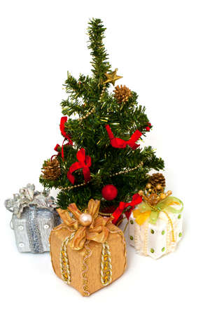Christmas tree and gifts isolated on white background photo