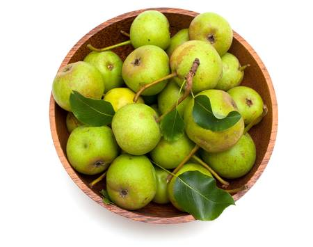 bowl with fresh pears isolated on white background photo