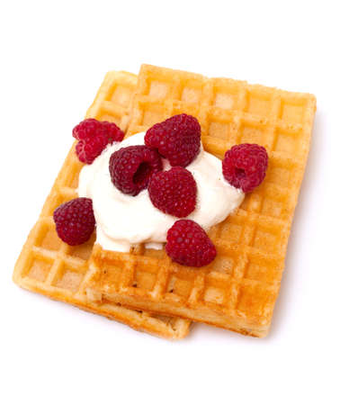 waffles with wheaped cream and raspberrries photo