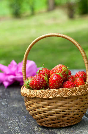 willow fruit basket: strawberries in basket on wooden table