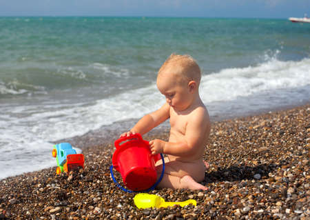 child playing with beach toys photo