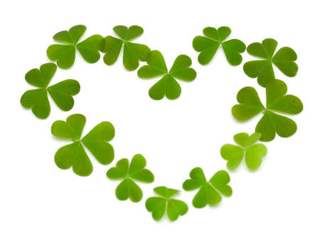 superstitions: heart made of clover isolated on white Stock Photo