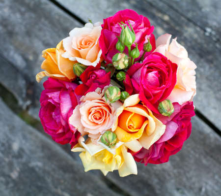 bouquet of roses on wooden table photo