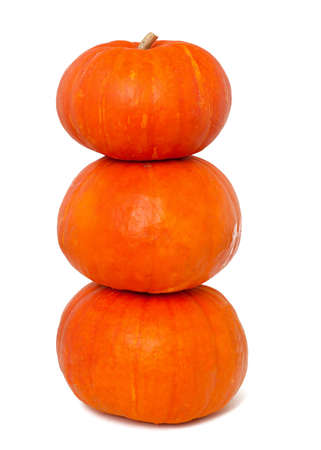 three stacked pumpkins isolated on white background photo