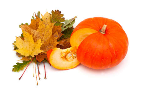 pumpkin and autumn leaves isolated on white photo