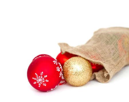 Christmas balls falling from the burlap bag Stock Photo