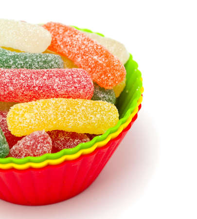 jelly candies in colorful cups isolated on white background photo