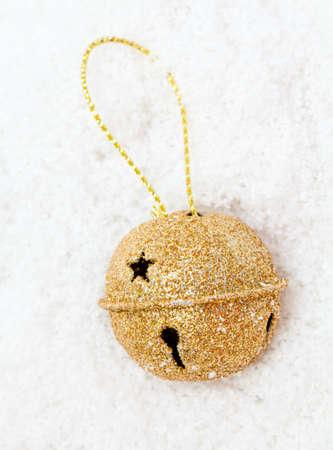 jingle bell: Christms golden bell on snow