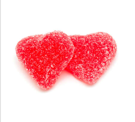 candy hearts: two heart-shaped candies isolated on white background Stock Photo