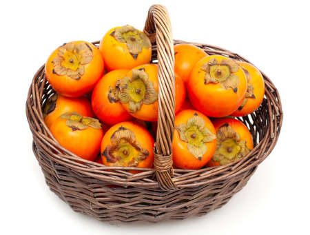 ebenaceae: persimmons in a basket Stock Photo