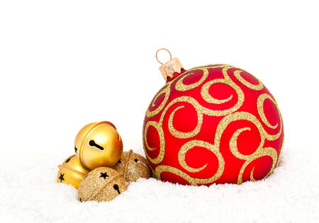Red Chritsmas Ball and golden bells on snow photo