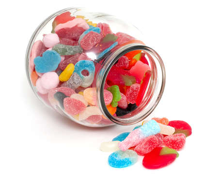assortment of jelly candy in a glass jar photo